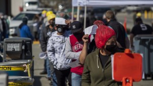 Farmworkers wait in line to receive the Moderna Covid-19 vaccine at a vaccination clinic organized by the Santa Clara County Public Health Department at Christopher Ranch in Gilroy, California, U.S., on Thursday, March 4, 2021.