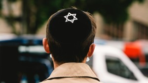 A man wears a kippah during the pro Israel anti Semitism rally in Cologne, Germany on May 20, 2021