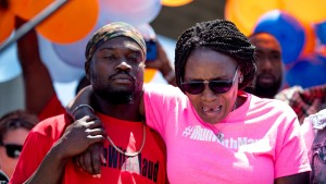 Wanda Cooper-Jones, mother of Ahmaud Arbery, weeps while people gather to honor her son at Sidney Lanier Park on May 9, 2020.