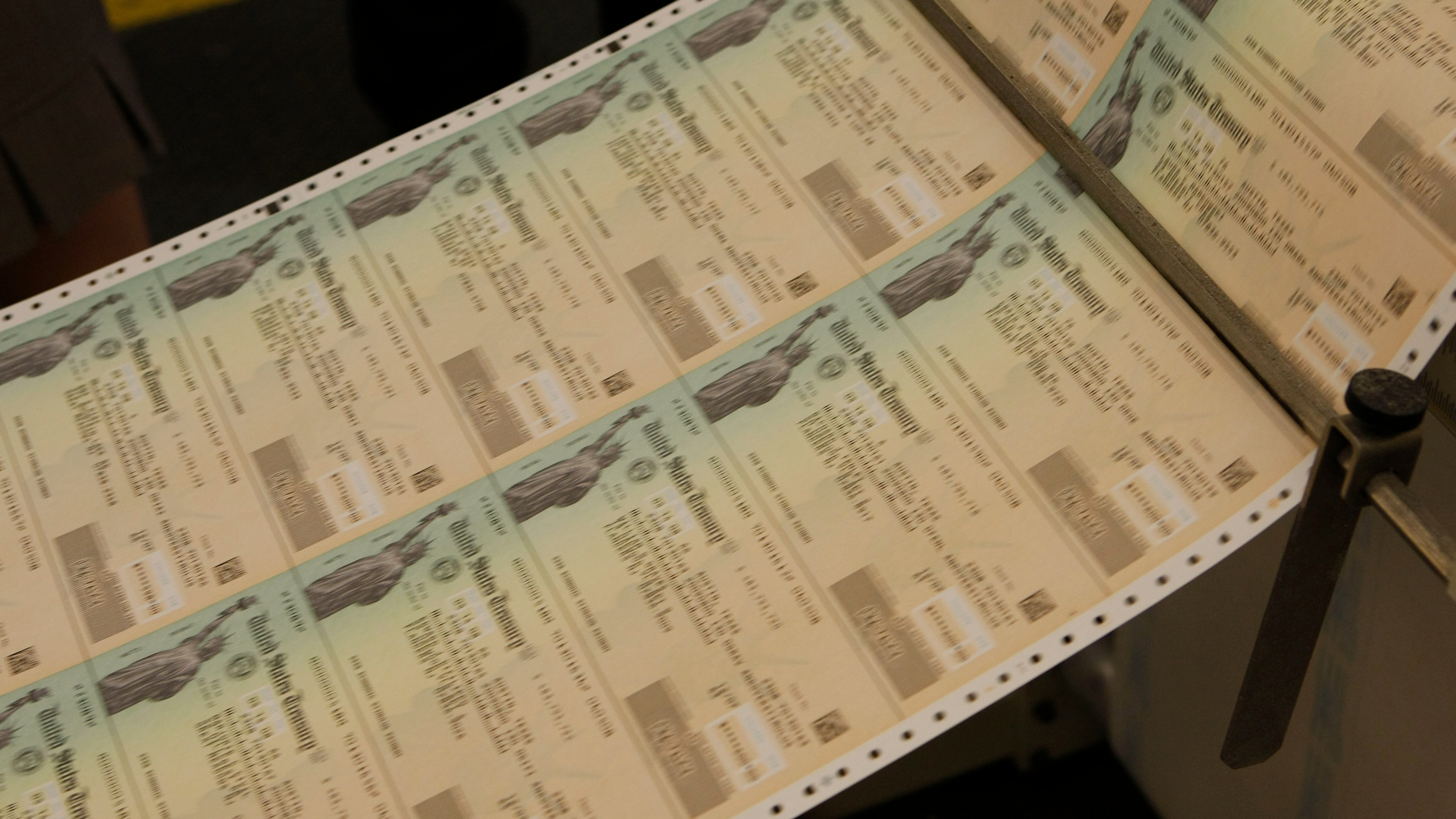Freshly printed economic stimulus checks roll off the presses
