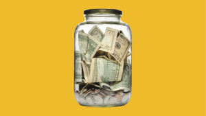 Jar filled with money.