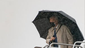 US President Joe Biden boards Air Force One in the rain at Andrews Air Force Base on March 31, 2021 in Maryland.
