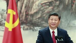 Chinese President Xi Jinping speaking at a podium