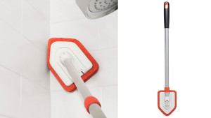 scrubbing brush with extendable arm to reach high-up areas