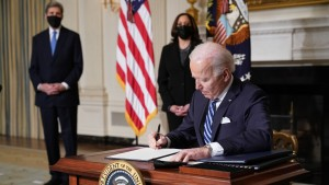 Biden signing executive orders on climate change on January 27, 2021.