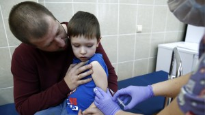 Boy getting MMR vaccine