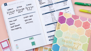 budgeting journal for personal finances, sticker pack, and markers