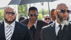 R. Kelly arrives for a hearing on sexual abuse charges