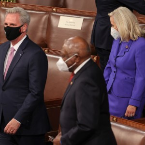 Rep. Kevin McCarthy (R-CA) and Rep. Liz Cheney (R-WY) pass Rep. James Clyburn (D-SC) as they arrive to attend President Biden address to a joint session of Congress.