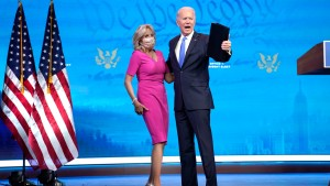 President-elect Joe Biden embraces his wife Dr. Jill Biden after speaking about the Electoral College vote. certification process at The Queen theater on December 14, 2020 in Wilmington, Delaware.