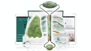 green jade roller set with gua sha tool to massage your face and improve circulation decrease puffiness