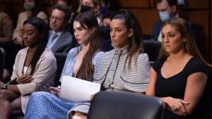 Simone Biles, McKayla Maroney, Aly Raisman and gymnast Maggie Nichols, arrive to testify during a Senate Judiciary hearing