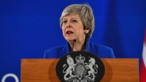 Theresa May at podium