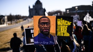 People march near the Minnesota State Capitol to honor George Floyd in St Paul, Minnesota.