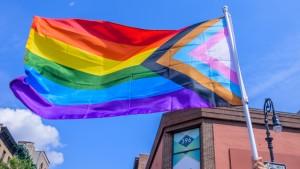 Participant holding a rainbow flag.