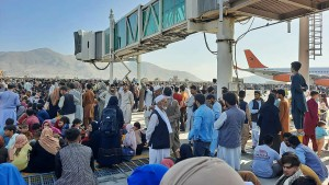 Afghans crowd at the tarmac of the Kabul airport on August 16, 2021, to flee the country as the Taliban were in control of Afghanistan after President Ashraf Ghani fled the country and conceded the insurgents had won the 20-year war.