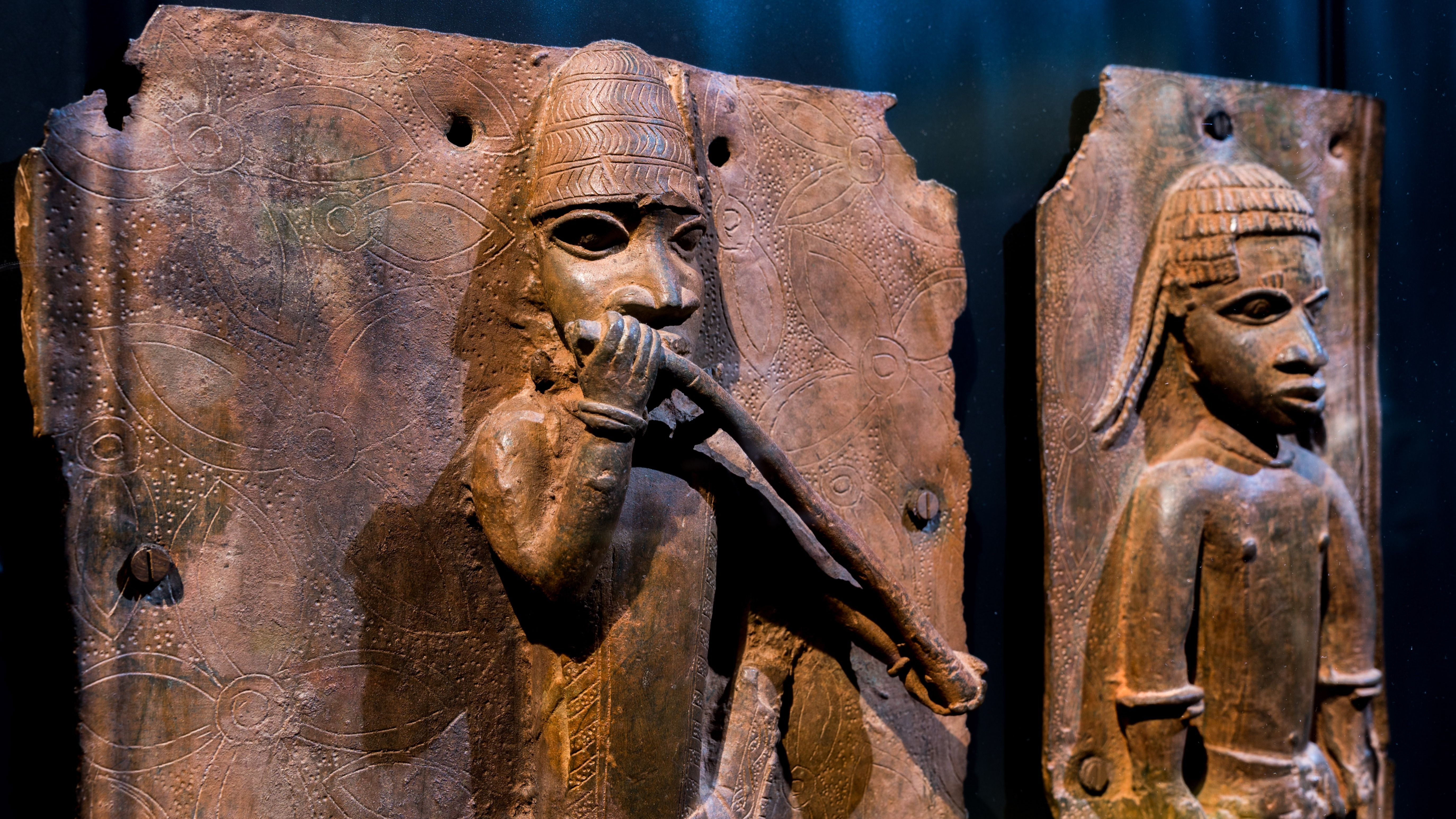 """Sculptures looted by British soldiers from the Kingdom of Benin in 1897 hangs on display in the """"Where Is Africa"""" exhibition at the Linden Museum on May 05, 2021 in Stuttgart, Germany."""