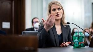Former Facebook employee and whistleblower Frances Haugen testifies during a Senate Committee