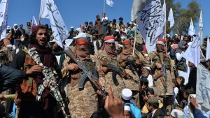 Afghan Taliban militants and villagers, March 2020.