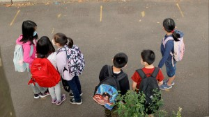 Students line up in the morning at Yung Wing School P.S. 124