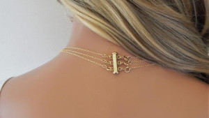 A layered necklace clasp