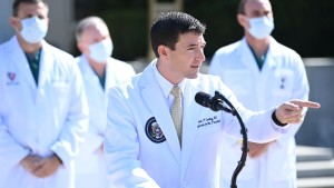 White House physician Sean Conley answers questions surrounded by other doctors, during an update on the condition of US President Donald Trump, on October 4, 2020, at Walter Reed Medical Center in Bethesda, Maryland.
