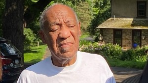 Bill Cosby speaks to reporters outside of his home.