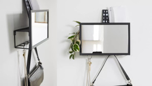 entryway organizer with hooks, a tiny shelf, and a mirror