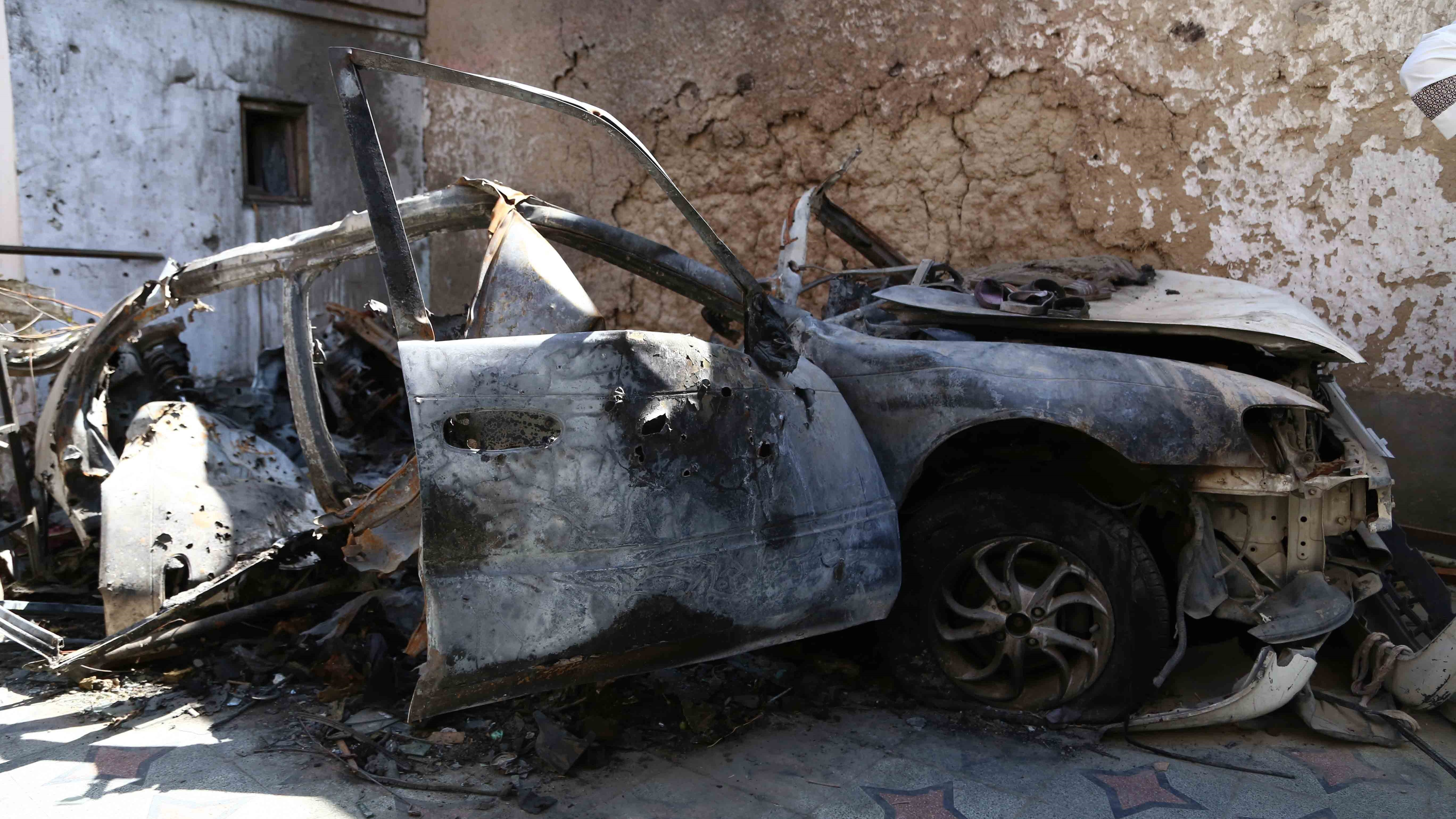 A damaged vehicle at a site of U.S. drone strike in Kabul, capital of Afghanistan