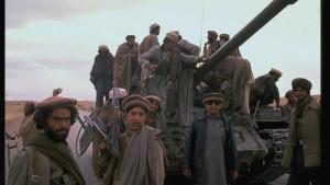 Mujahideen during rebel assault on Jalalabad: w. captured Soviet T 55 tank.