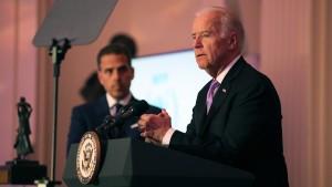 Hunter Biden (L) and U.S. Vice President Joe Biden speak on stage at the World Food Program USA's Annual McGovern-Dole Leadership Award Ceremony at Organization of American States on April 12, 2016 in Washington, DC.