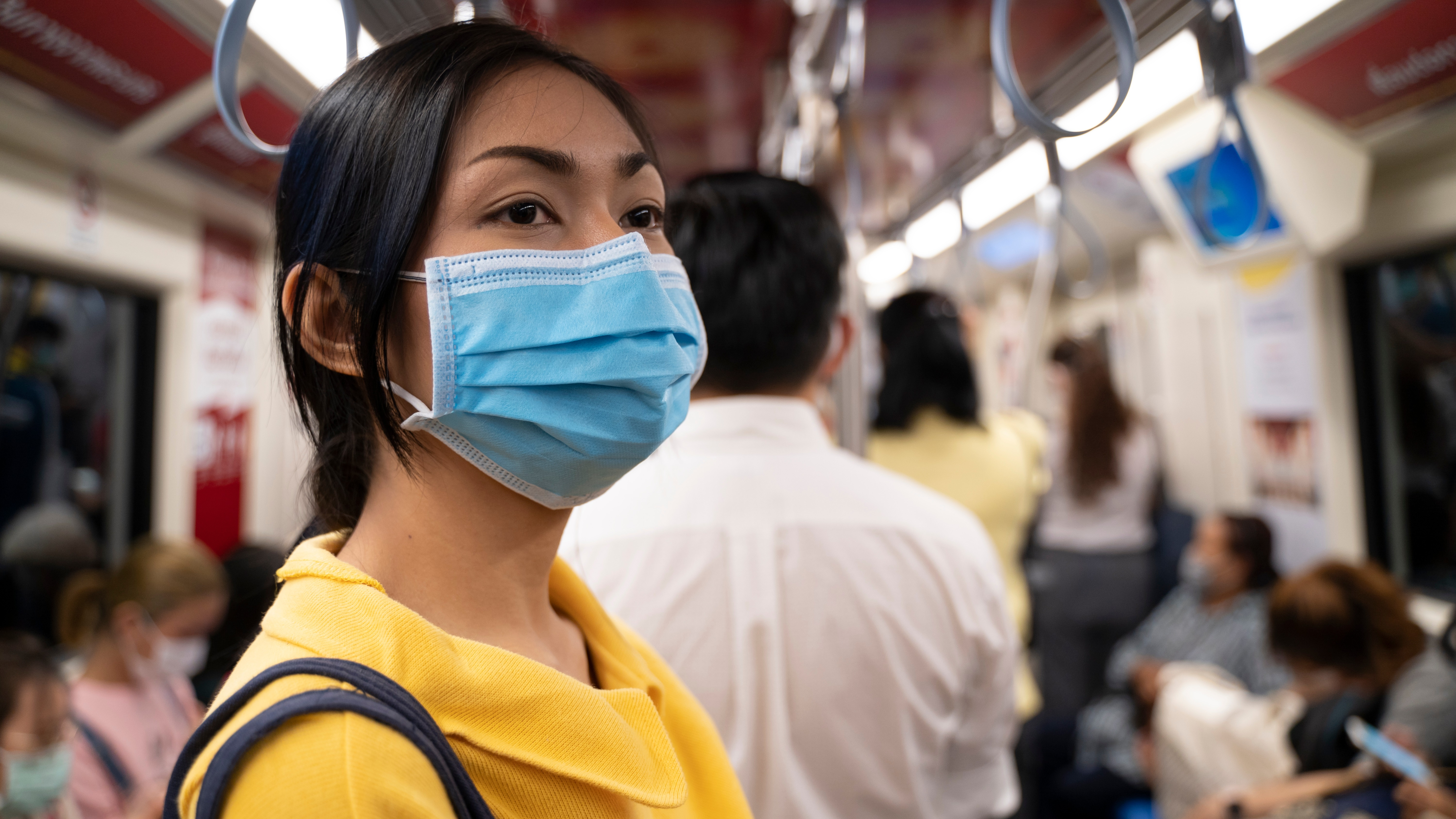 Woman on train wearing mask