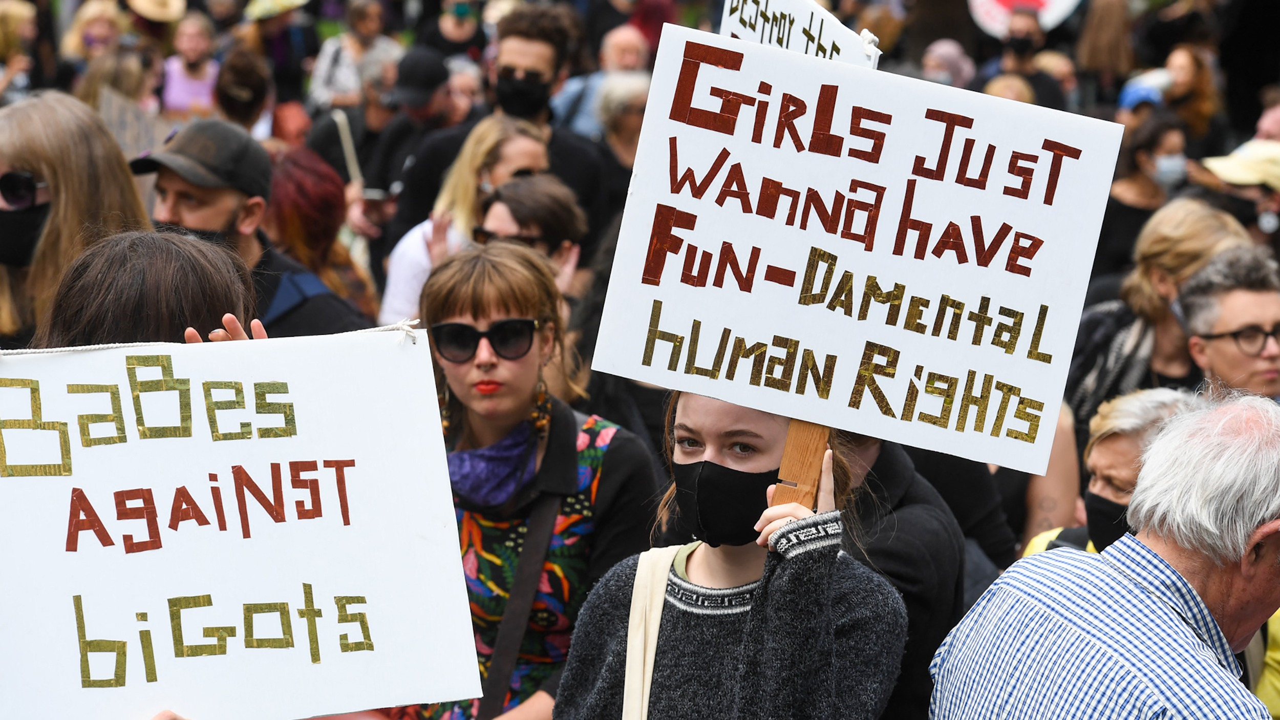 People attend a protest against sexual violence and gender inequality