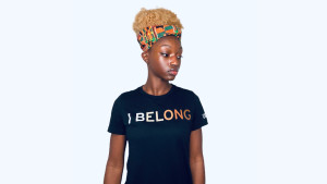 black t-shirt with 'I Belong' saying printed on the front in different colors