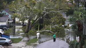 A person looks at a flooded neighborhood as Hurricane Sally passes through Pensacola, FL