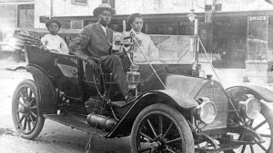 View of American businessman John Wesley Williams sits in his car with wife Loula Williams and their son, WD Williams, Tulsa, Oklahoma, 1910s