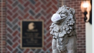 A mask adorns a statue of a lion in front of the Alpha Delta Pi sorority house on September 3, 2020 in Columbia, South Carolina.
