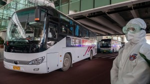 A bus carrying members of the World Health Organization (WHO) team investigating the origins of the Covid-19 pandemic leaves the airport following their arrival in Wuhan, China.