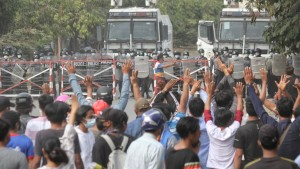 Protesters chant slogans during an anti-coup protests continue in Mandalay, Myanmar on February 20, 2021.