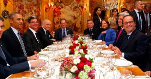 President Obama sits with French President Francois Hollande, Secretary of State John Kerry, and other officials as they have dinner at the Ambroisie restaurant in Paris