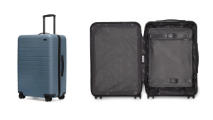 durable suitcase with a hard outer shell, inner laundry bag, and four wheels