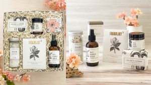 relaxation gift box with bath goodies, a candle, a linen spray, and more