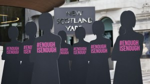 Cut-out silhouettes representing women are set up outside the Metropolitan Police headquarters