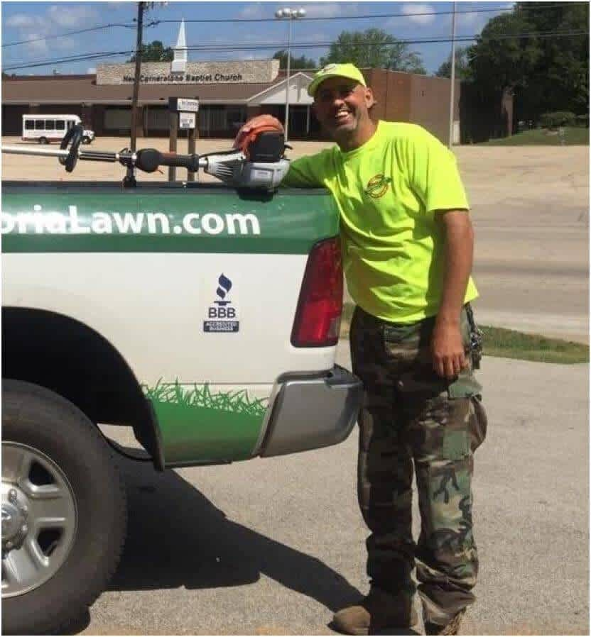 Dave Bachman of Peoria Lawn standing next to work truck