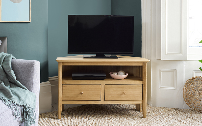scandinavian style tv stand in botanical living room