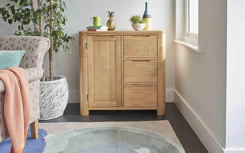 modern curved oak sideboard with colourful accessories