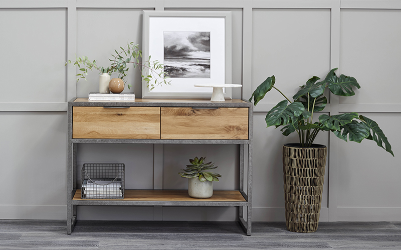 industrial oak and metal console table accessorised with indoor plants