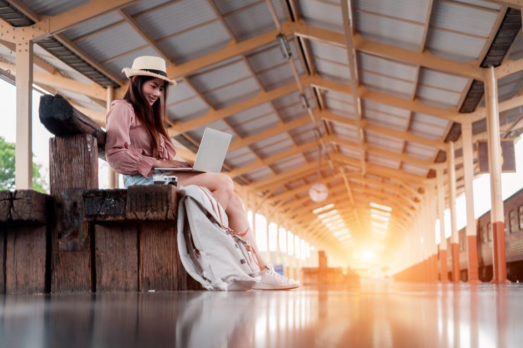 Traveler Open Laptop on Train Station