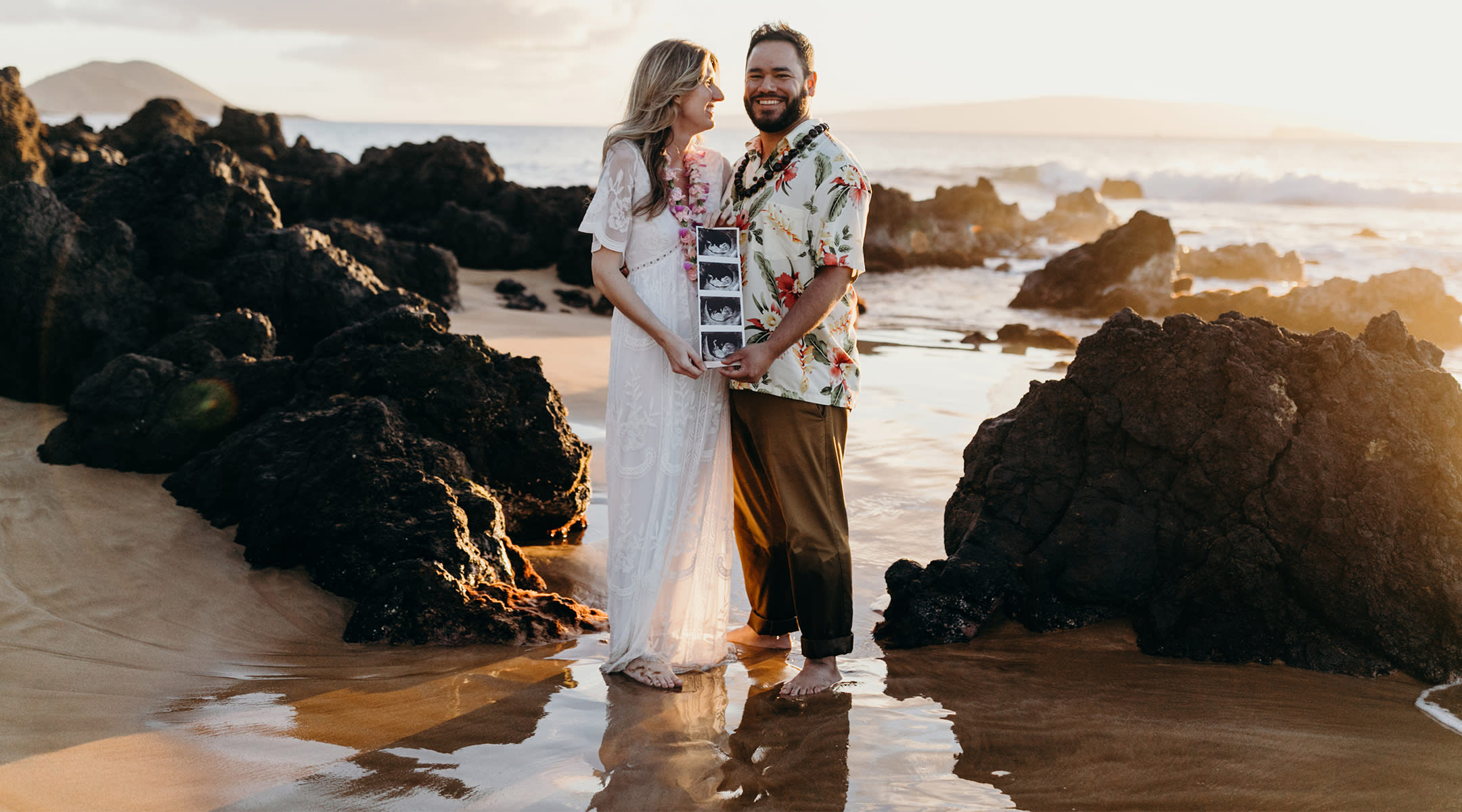 pregnant woman with her partner on babymoon in maui, hawaii