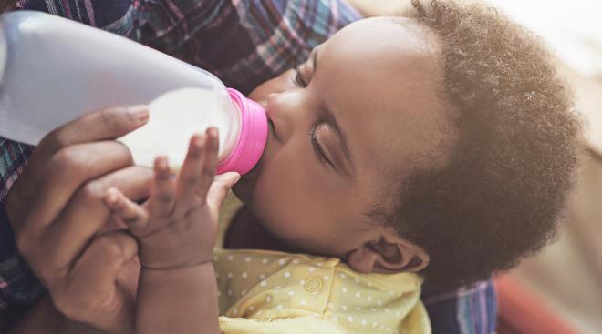 Parent bottlefeeding baby.